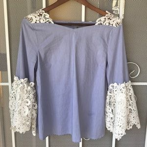 Blue striped top with white crochet lace